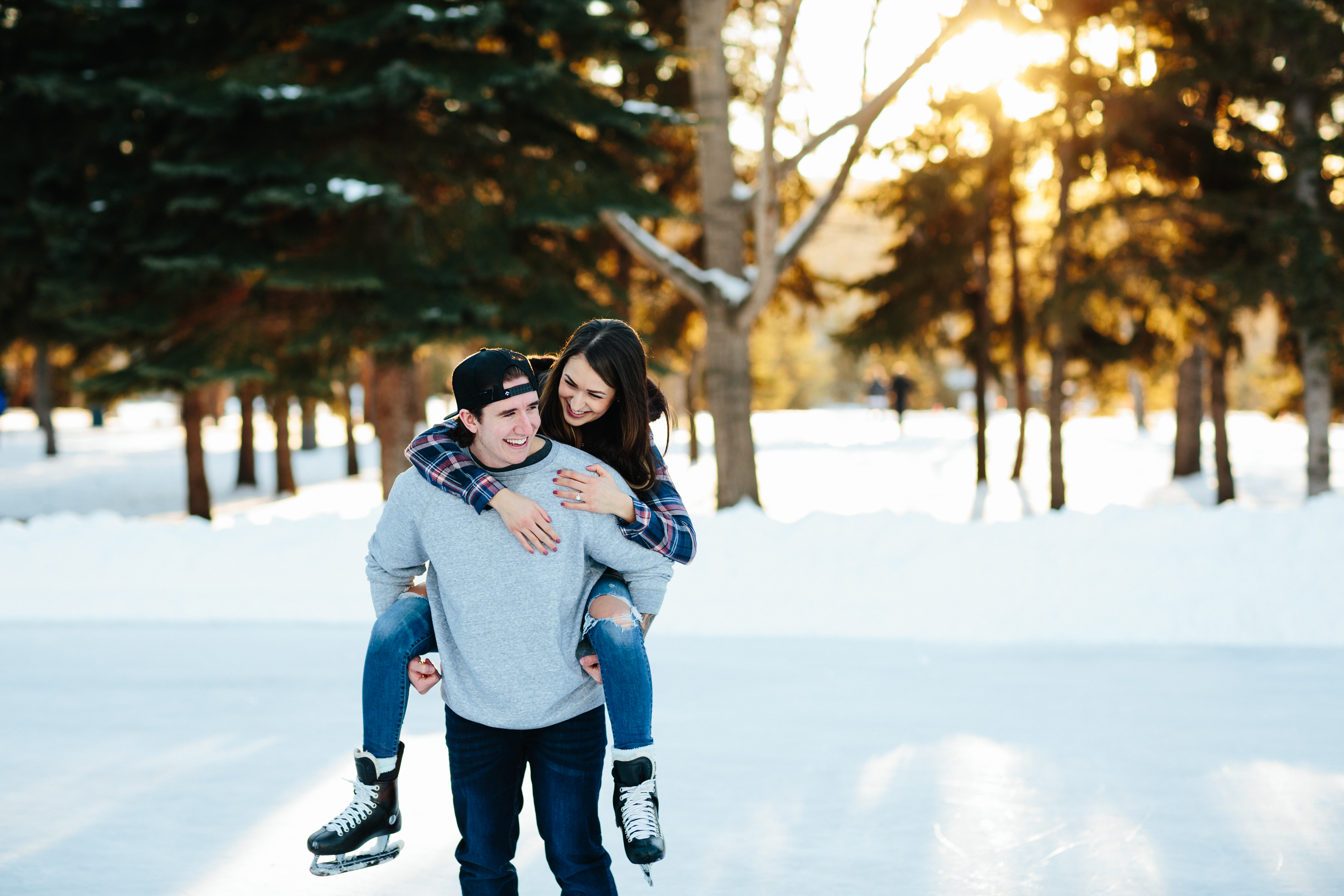 Roughley Originals Engagement Photography. Couple ice skating in Edmonton.