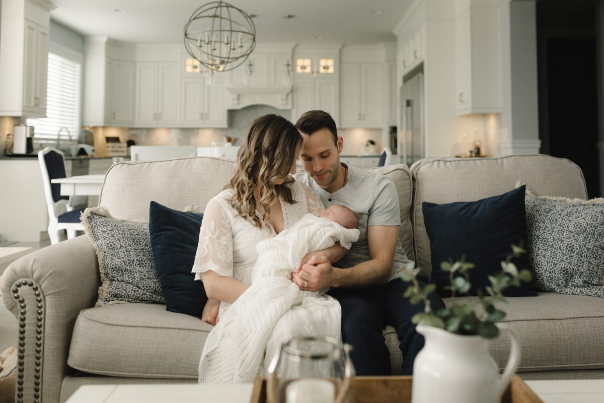 Keira and Mike holding baby Levon in their Roughley Originals Lifestyle newborn Session.