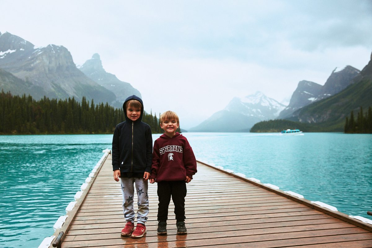 Callum and Max on the dock by Spirit Island, Maligne Lake in Jasper National Park.
