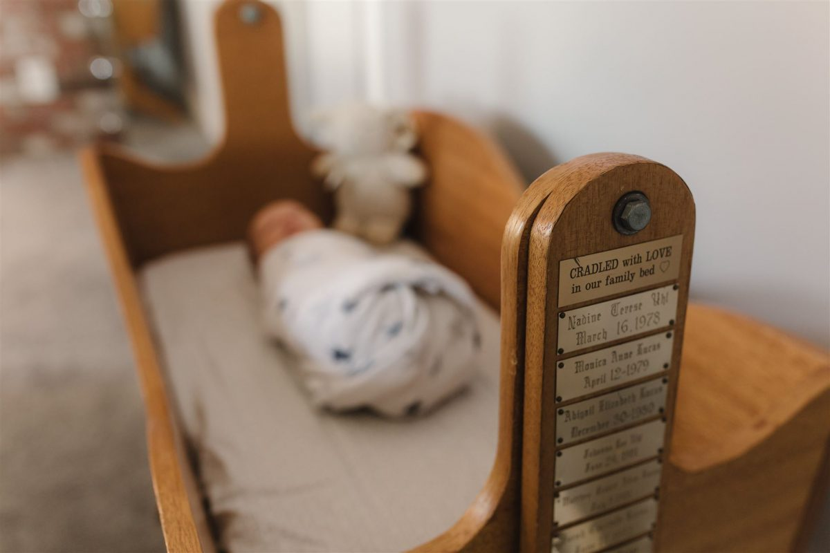 home made crib and baby at his newborn session by Roughley Originals